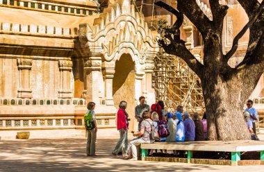 BAGAN, MYANMAR - DECEMBER 1, 2016: Group of tourists near the bu