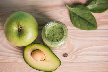 apple with avocado and smoothie in glass jar