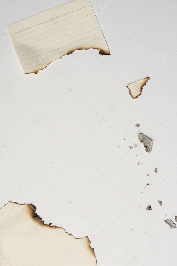 pieces of paper sheet with burned edges