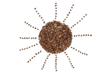 Sun symbol made from coffee beans