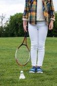 Dívka s badminton raketa