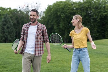 couple with badminton racquets