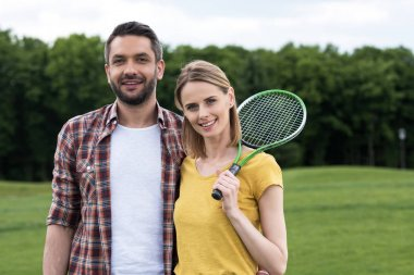 Couple with badminton racquet