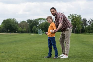 Father and son playing badminton
