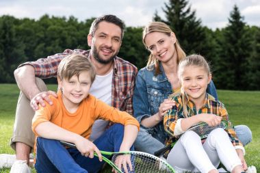 Happy family with badminton racquets