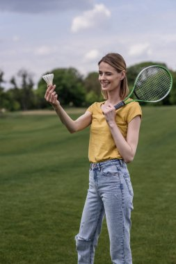 Woman holding badminton racket and shuttlecock