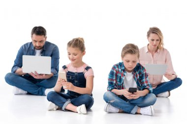 Family using different digital devices
