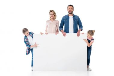 Kids pointing at blank banner in parents hands isolated on white stock vector