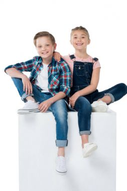 children sitting on cube