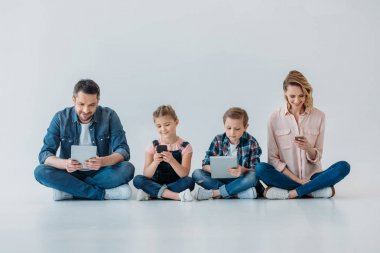 happy family using digital devices