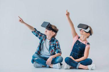 kids using virtual reality headsets