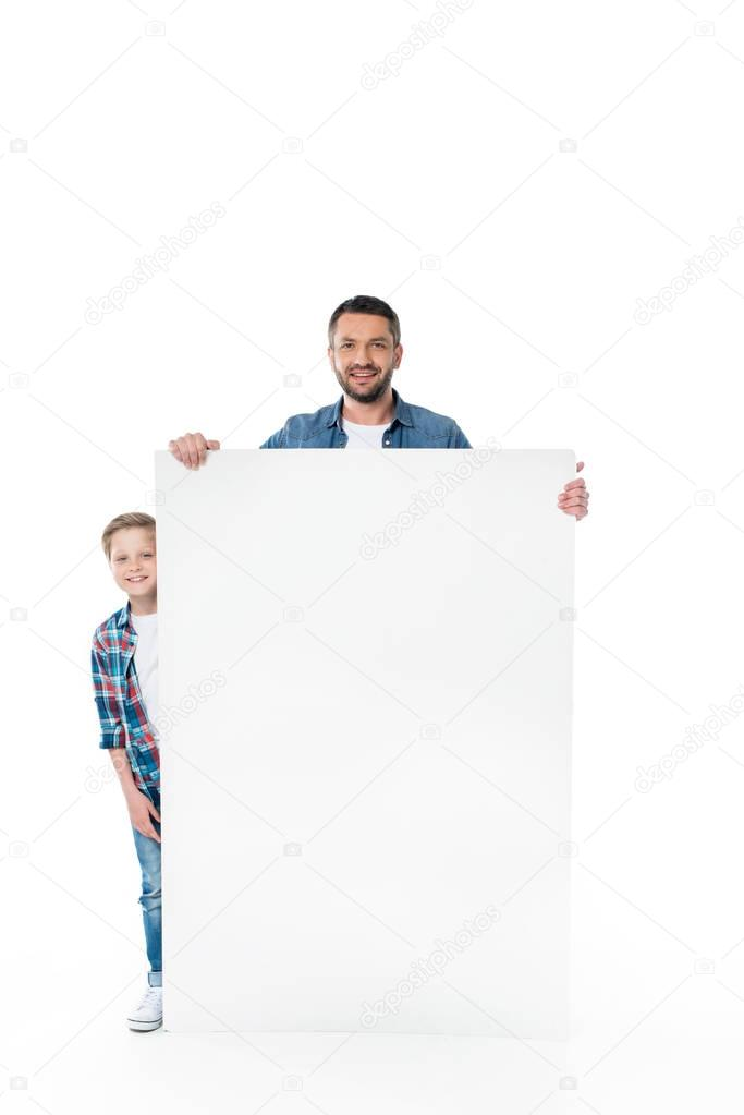 father and son with blank banner