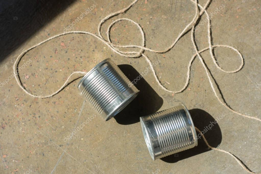 aluminium tin cans connected with rope