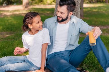 Father and daughter at picnic