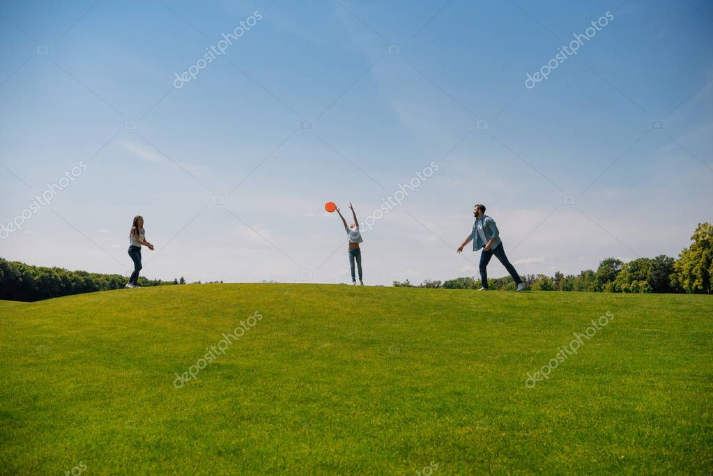 Family playing with flying disk