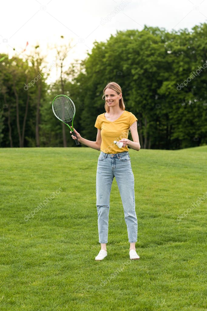 woman with badminton racquet