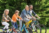 Photo family riding bicycles