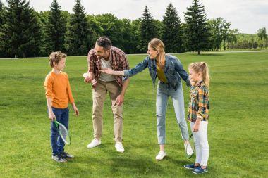 family playing badminton