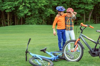kids standing near bicycles