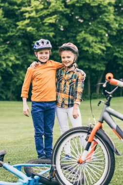 children with bicycles at park