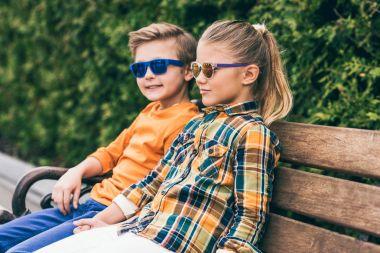 children sitting on bench