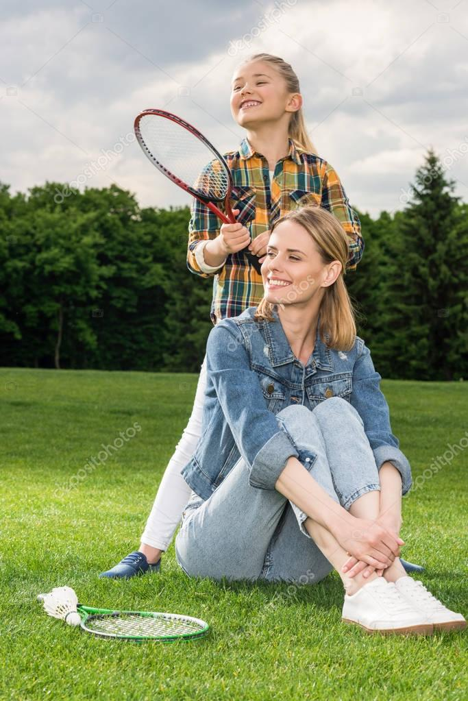 family with badminton racquets