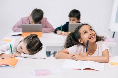 multiethnic schoolkids in classroom