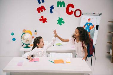 multiethnic schoolgirls in classroom