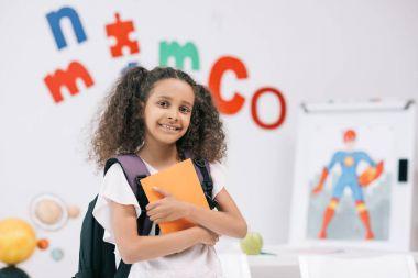 African american schoolgirl in classroom