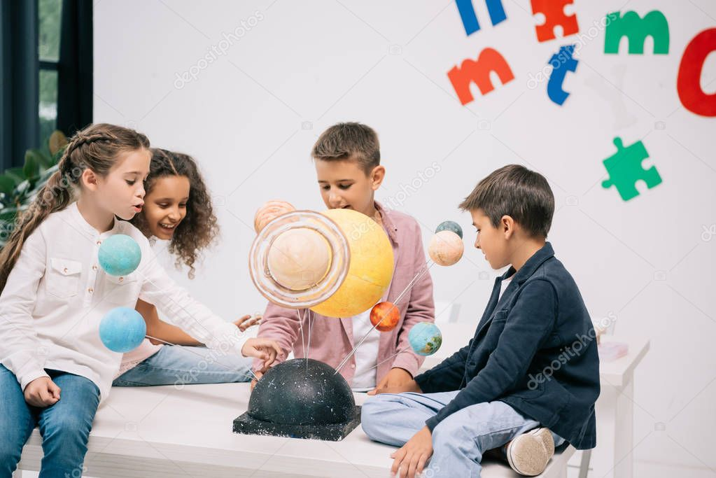 Schoolchildren with solar system