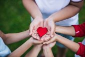 Children holding heart symbol