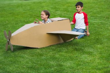Children playing with toy plane