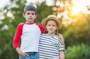 Adorable siblings in park