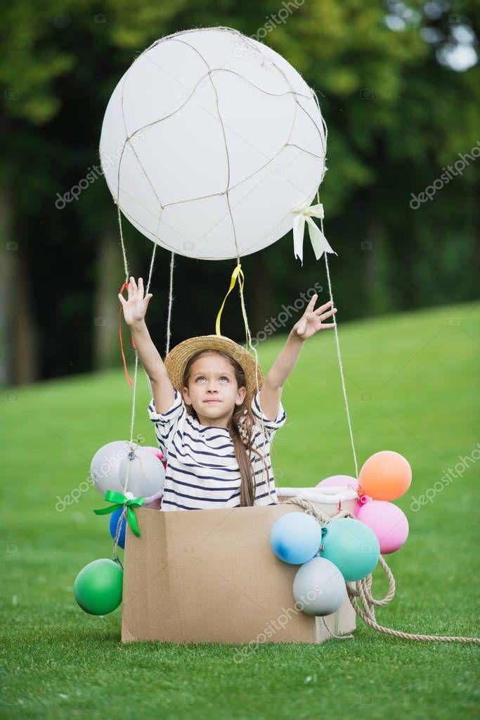 Girl in hot air balloon