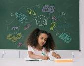 African american schoolgirl studying