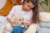 Photo african americna girl and puppy