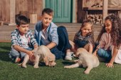 multiethnic kids with cute puppies