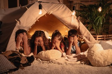children resting in tent at home