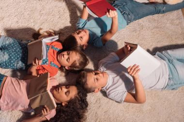 multiethnic children reading books