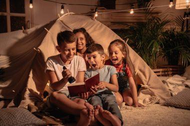 multiethnic children reading book