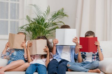 children with books at home