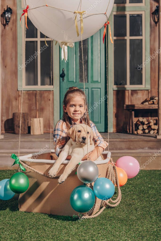 girl with puppy in air balloon box