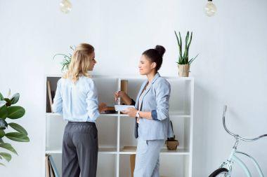 multiethnic businesswomen discussing work