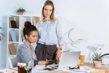 multiethnic businesswomen working on laptop