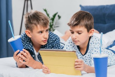 boys using tablet at home