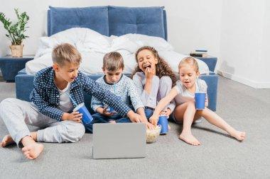 multicultural children watching movie