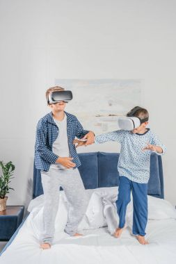 Boys in virtual reality headsets