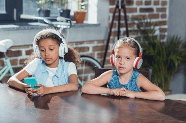 Multicultural girls in headphones