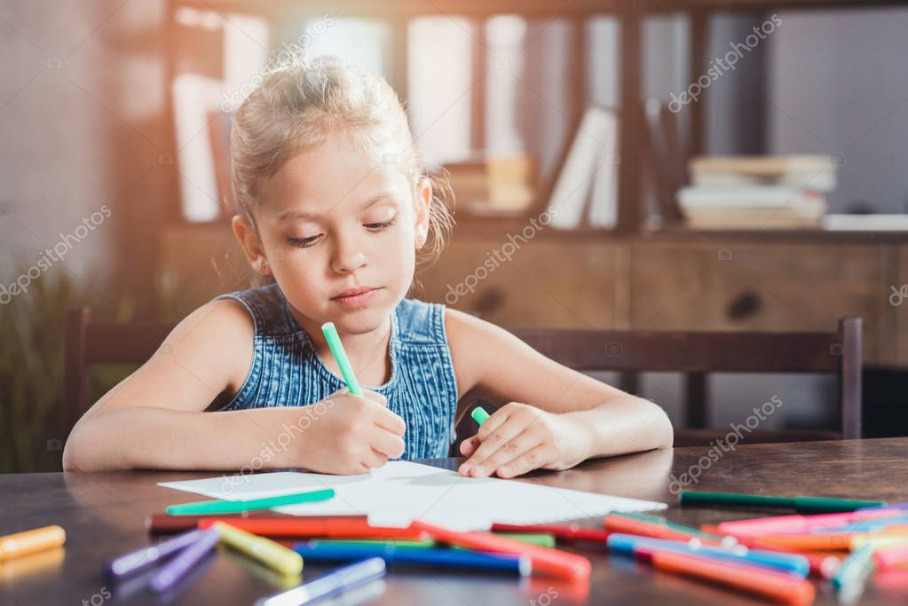 cute girl drawing picture