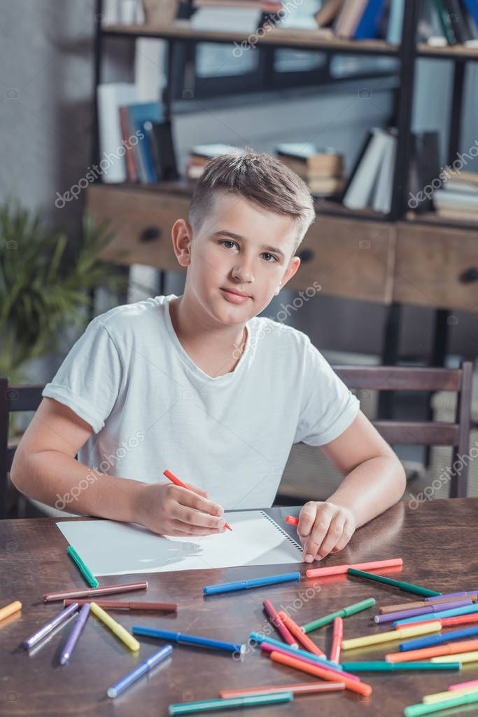 little boy drawing picture